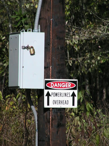 Power supply and warning sign
